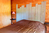 St Cirq Lapopie chalet's bedroom with double bed